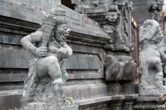BALI, INDONESIA - DECEMBER 13, 2017: carved statue stand outside entrance to Hindu temple stock image