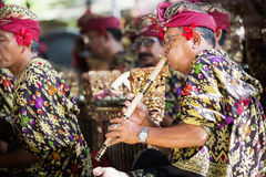 BALI, INDONESIA, DECEMBER, 24,2014: Musicians in the troupe play. Traditional Balinese music to accompany dancers in a 'Barong Dance show' in Ubud village on royalty free stock photography
