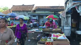 Bali, Indonesia - February 21, 2019: Balinese traditional food market at morning time. People on market. stock footage