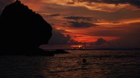 Bali, Indonesia - January 10, 2018: Timelapse of Sunset over tropical cliff. Bali, Indonesia - January 10, 2018: Timelapse of picturesque sunset over tropical stock video footage