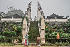 Tourists near the entrance to the Pura Lempuyang temple royalty free stock photo