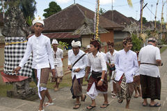 BALI, INDONESIA - JUL 7TH: Boys on their way to the temple on Ju Royalty Free Stock Photography
