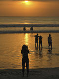 BALI - INDONESIA - JULY 2007: Silhouette of people at sunset over ocean Stock Photography
