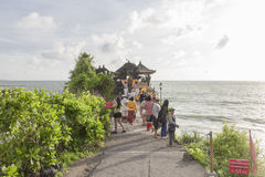 Bali, Indonesia - July 23, 2016: Tourists walk near the Tanah Lo Royalty Free Stock Photography