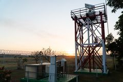 BALI/INDONESIA-JUNE 06 2019: sunrise in the morning at the location of a radar tower that detects volcanic dust at an airport royalty free stock photo