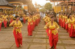 Beautiful indonesian people group in colorful sarongs - traditional Balinese style ethnic dancer costumes at Bali Arts and. Bali, Indonesia- March 5, 2018 stock photo