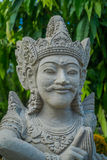 BALI, INDONESIA - MARCH 08, 2017: Close up of a beautiful stone statue inside of the Royal temple of Mengwi Empire Stock Image