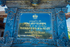 BALI, INDONESIA - MARCH 08, 2017: Informative sign on a black cement of Subak Abian Selonding, Bali, Indonesia Royalty Free Stock Photography