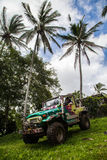Bali. Indonesia - March 7, 2013 SUV in the tropical jungle. Stock Photography
