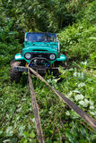 Bali. Indonesia - March 7, 2013 SUV in the tropical jungle. Royalty Free Stock Photo