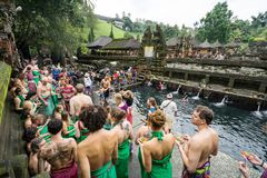 Tourist wash themselves in the pool at Pura Tirta Empul Stock Photo