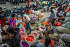 BALI, INDONESIA - MARCH 08, 2017: Unidentified people in outdoors Bali flower market. Flowers are used daily by Balinese Royalty Free Stock Image