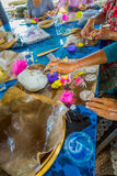 BALI, INDONESIA - MARCH 08, 2017: Women preparing an Indian Sadhu dough for chapati on Manmandir ghat on the banks of Royalty Free Stock Photo