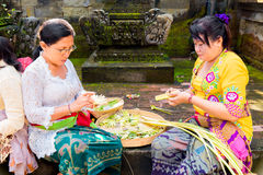 Bali, Indonesia, May 3, 2015. Balinese women make decorations of Stock Photo