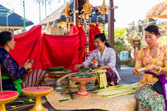 Bali, Indonesia, May 3, 2015. Balinese women make decorations of Stock Photography