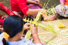 Bali, Indonesia, May 3, 2015. Balinese women make decorations of Royalty Free Stock Photography