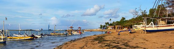 Colorful Bali Fishing Boats Panorama on Sanur beach, Indonesia. royalty free stock photos