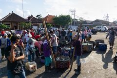 BALI/INDONESIA-MAY 15 2019: Fishermen who have finished fishing immediately sell their catch. They queued to be weighed by the stock photos