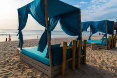 Sunbeds on Jimbaran beach in Bali, Indonesia Stock Photos