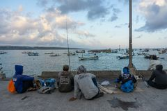 BALI/INDONESIA-MAY 15 2019: On a sunny and slightly cloudy day, some people are spending their weekend with fishing. They are stock images