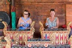 BALI, INDONESIA - MAY 5, 2017: Women playing on Traditional Balinese music instrument gamelan. Bali island, Indonesia. Stock Image