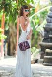 BALI, INDONESIA - NOVEMBER 15, 2017: Closeup of luxury snakeskin python handbag in woman hands. Brand BaliSnake Royalty Free Stock Photography