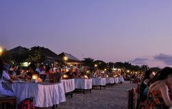 Dinner in the evening on the beach royalty free stock images
