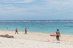 BALI, INDONESIA - OCTOBER 8, 2017: Friends playing football at the beach Pandawa, Bali. BALI, INDONESIA - OCTOBER 8, 2017: Friends playing football at the beach Royalty Free Stock Images