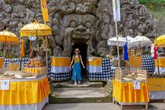 Tourist came out from Goa Gajah temple. Bali, Indonesia - September 17, 2018: Tourist came out from Goa Gajah temple, also known as Elephant cave, famous stock photography