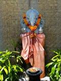 BALI INDONEZJA, MARZEC, - 11, 2017: Hinduska balijczyk świątynia z statuy lub kamienia rzeźbą Ganesha słonia bóg Fotografia Stock