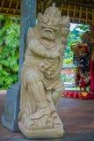 BALI INDONEZJA, MARZEC, - 08, 2017: Piękna kamienna statua wśrodku Królewskiej świątyni lokalizować w Mengwi Mengwi imperium Fotografia Royalty Free