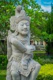 BALI INDONEZJA, MARZEC, - 08, 2017: Piękna kamienna statua wśrodku Królewskiej świątyni lokalizować w Mengwi Mengwi imperium Obraz Royalty Free