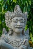 BALI INDONEZJA, MARZEC, - 08, 2017: Zamyka up piękna kamienna statua wśrodku Królewskiej świątyni Mengwi imperium Obraz Stock
