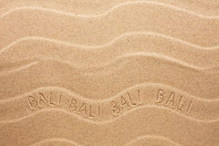 Bali inscription on the wavy sand Stock Image