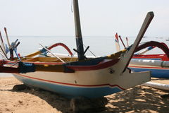 Bali island boat. Fishing boat on beachfront near water Royalty Free Stock Photography