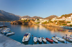 Bali, Island Crete, Greece, - June 24, 2016: Beautiful morning scenery scenery with mountains, Mediterranean sea and pier with boa Royalty Free Stock Images