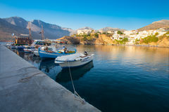 Bali, Island Crete, Greece, - June 24, 2016: Beautiful morning scenery scenery with mountains, Mediterranean sea and pier with boa Royalty Free Stock Photo