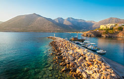 Bali, Island Crete, Greece, - June 24, 2016: Beautiful morning scenery scenery with mountains, Mediterranean sea and pier with boa Stock Image