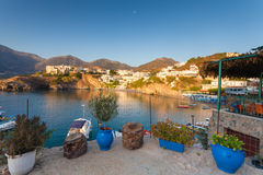 Bali, Island Crete, Greece, - June 24, 2016: Morning scenery with mountains, Mediterranean sea and small bay with boats of local f Stock Photos
