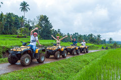BALI ISLAND, INDONESIA - AUGUST 25, 2008: Group of tourists driv stock photos