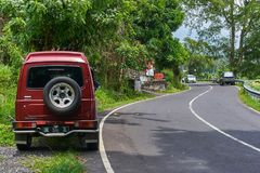 BALI ISLAND, INDONESIA - DECEMBER 17, 2017: Small car on the mountain road stock images