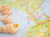 Bali Travel Maps with Seashells and with popular destination is Nusa Dua Beach Stock Images