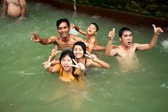 BALI - JANUARY 3 : Happy balinese bathe in the hot springs on JANUARY 3, 2013, Bali, Indonesia Stock Photos