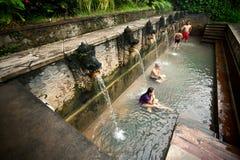 BALI - JANUARY 3 :  People take a bath in termal Banjar Tega hot Stock Photography