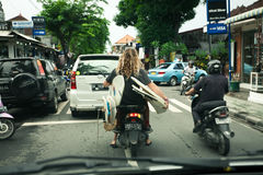 BALI - JANUARY 4 :  Tourist with surfboards on scooter on JANUAR Stock Photos