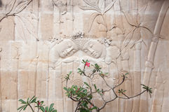 Bali limestone carving. Section of an ancient mural limestone carving from Bali Stock Photo