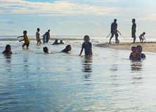 Bali local people swimming river Royalty Free Stock Image