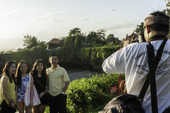 Bali local Photographer in action Royalty Free Stock Images