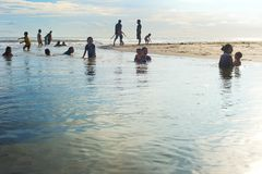 Bali locals swimming in river Stock Images