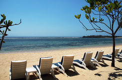 Bali - Nusa Dua Beach. Nusa Dua Beach & loungers on a typically beautiful day in Bali Stock Photos